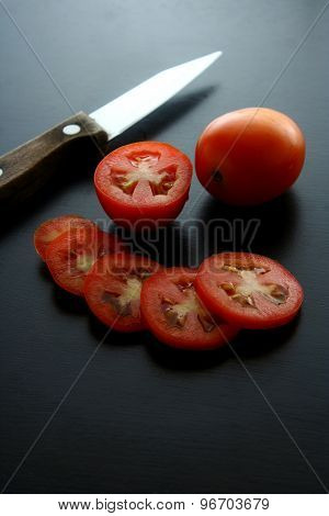 Knife and fresh ripe tomatoes