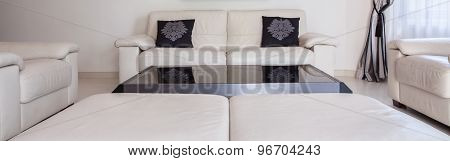 White Couch With Black Cushions