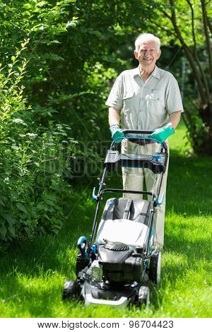 Elder Man Cutting Grass