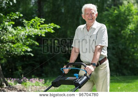 Smiling Retiree With Lawn Mower