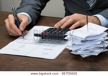 Businessperson Calculating Financial Expenses