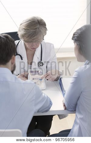 Gynecologist Explaining In Vitro Process