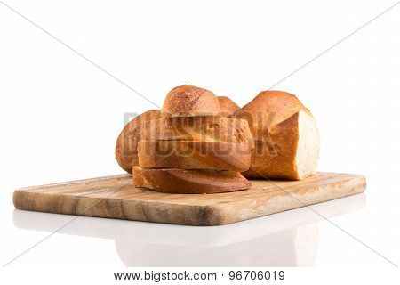 Sliced Bread On A Wooden Chopping Board