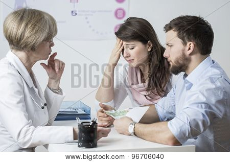 Infertile Couple Giving A Bribe