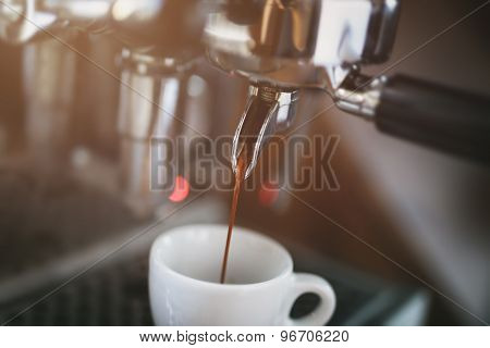 coffee extraction process from professional espresso machine, close up