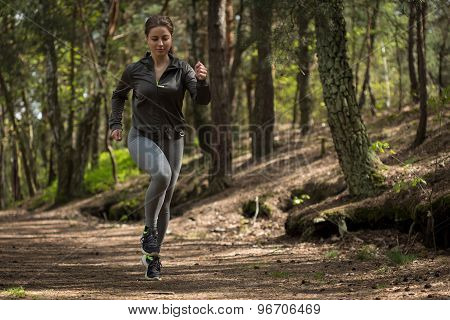 Active Jogger Running In Nature