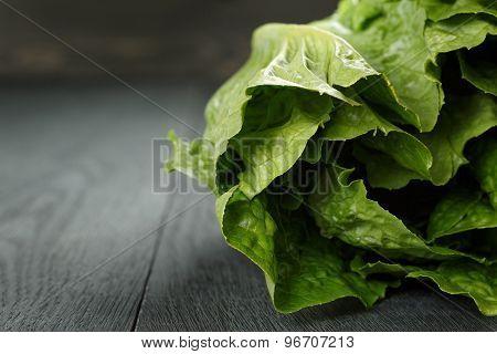 fresh romain green salad on wood table
