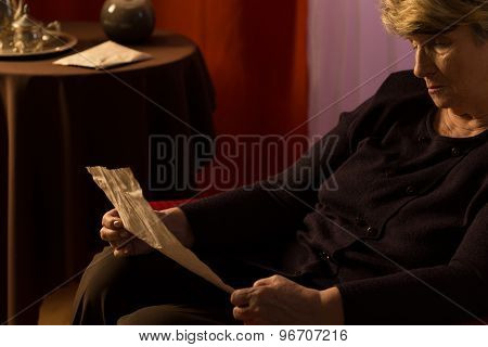 Elder Woman Reading A Letter
