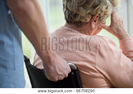 Sad Woman On Wheelchair