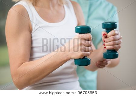 Holding The Dumbbells