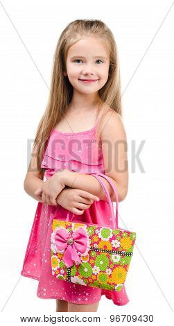 Portrait Of Smiling Cute Little Girl With Bag