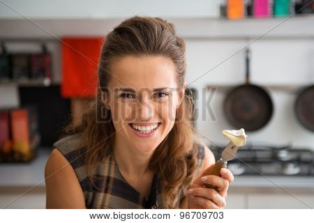 Closeup Of Smiling Woman Holding Camembert Slice On Cheese Fork