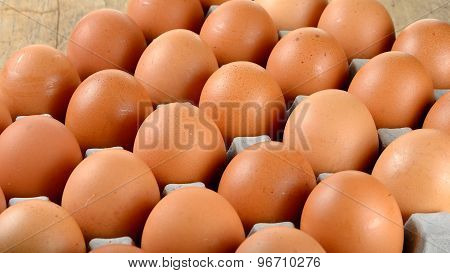 Close Up Egg In Packet On Wooden Background