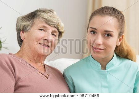 Smiling Elderly Woman And Caregiver