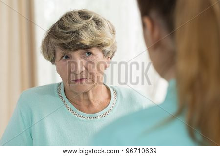 Sad Senior Female In Nursing Home
