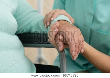 Nurse Supporting Old Woman