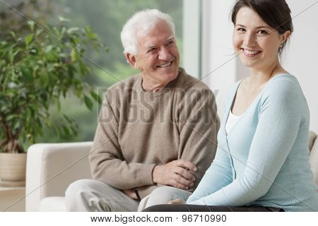 Smiling Grandpa And Caring Granddaughter
