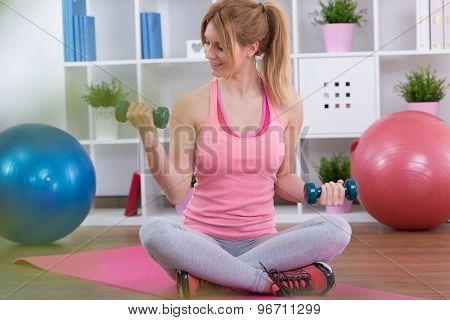 Teenage Girl Exercising With Dumbbells