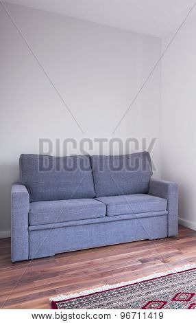 Grey Couch On Wooden Floor