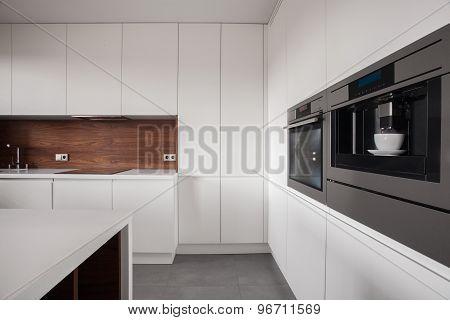 White Furniture In Wooden Kitchen