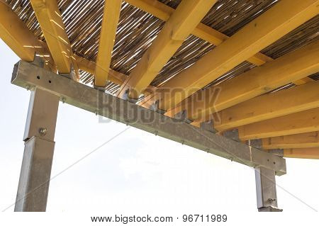 Pergola Structures Of Metal And Wood With Thatched Roof