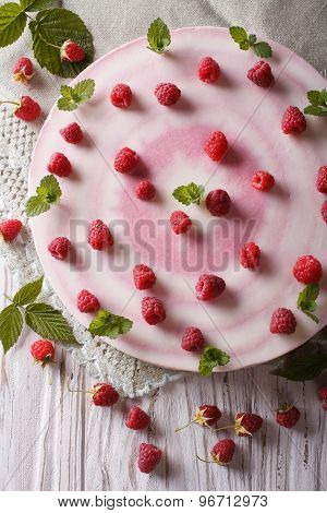 Cheesecake With Fresh Raspberries Decorated With Mint Close Up
