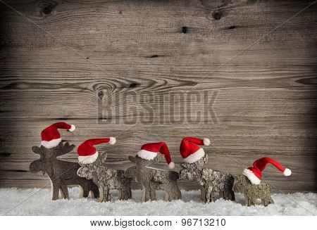 Five wooden handmade reindeer on a background with place for text.