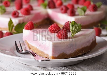 Sweet Cheesecake With Raspberries And Mint Close-up On. Horizontal