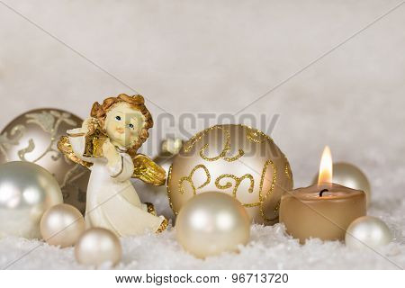 Christmas greeting card with angel and candle in gold, silver and white colors.