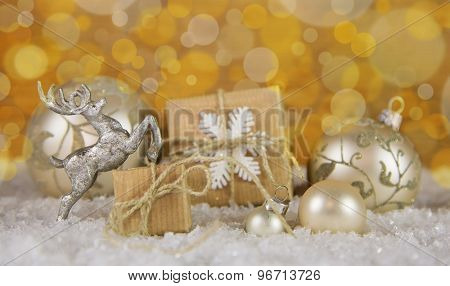 Christmas decoration in gold, silver and white with gift boxes.