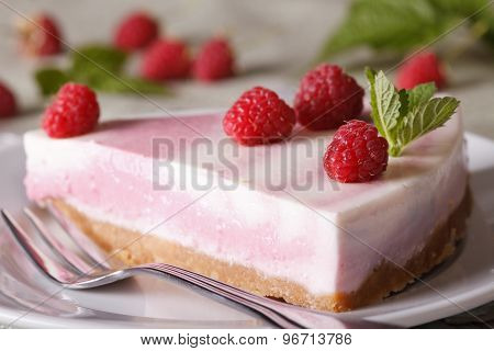 Pink Cheesecake With Raspberries Close-up On A Plate. Horizontal