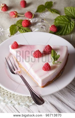 Piece Of Raspberry Cheesecake Close-up On A Plate. Vertical Top View