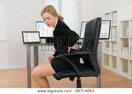 Businesswoman Suffering From Backache In Office