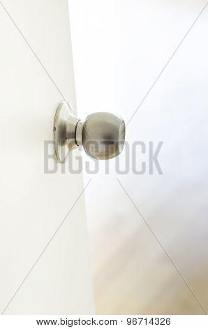Close Up - White Half-open Door Into Room