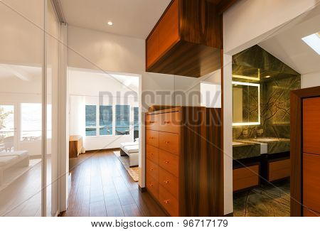 Modern house interior, corridor overlooking bathroom, nobody inside