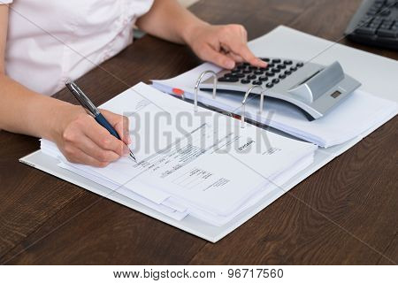 Accountant Calculating Bills