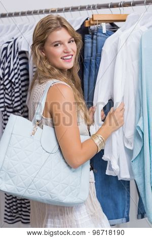 A happy smiling woman in a clothing store