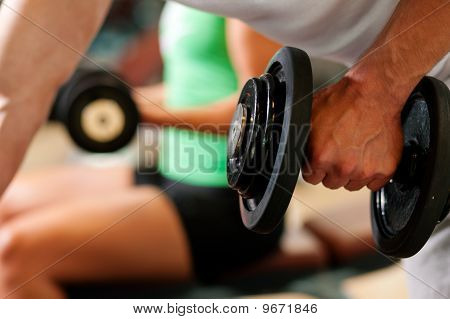 Dumbbell training in gym