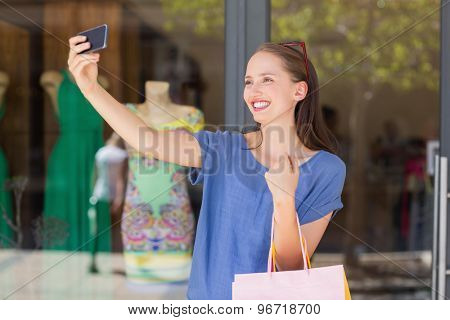 Happy woman taking a selfie with a smartphone
