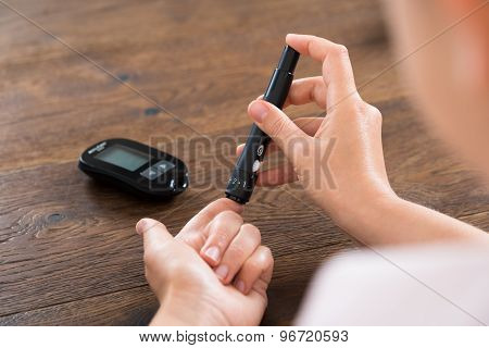 Woman Hands With Glucometer