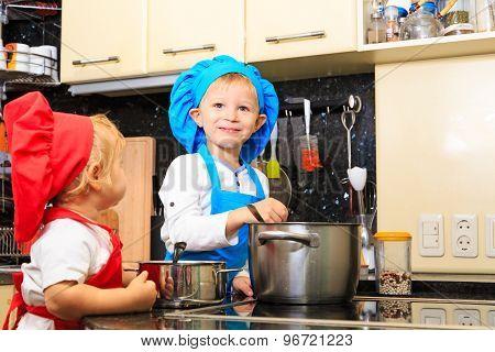 kids cooking in kitchen interior