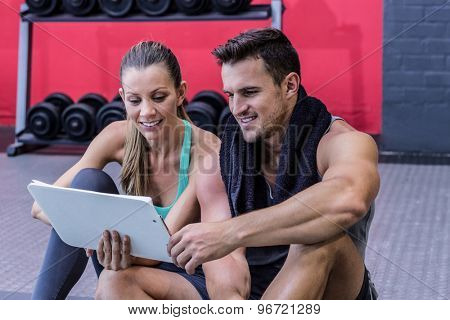 Female coach explaining directives to a muscular man