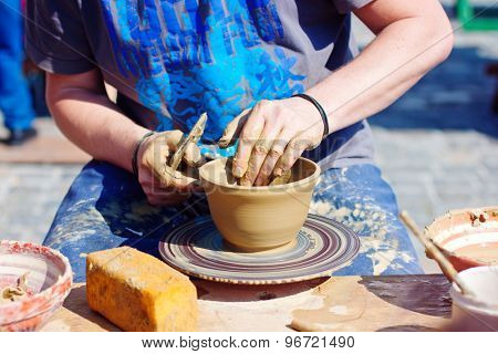 Man working on a Cpottery wheel