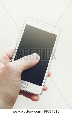 Human hand and blank smartphone screen