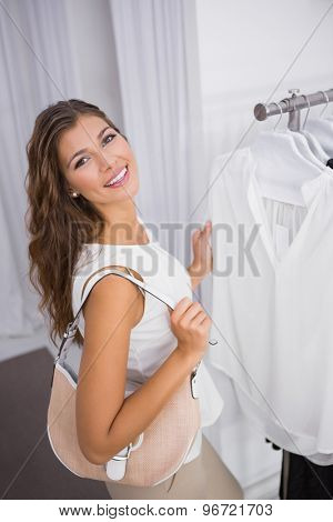 Portrait of smiling woman looking at camera at a boutique