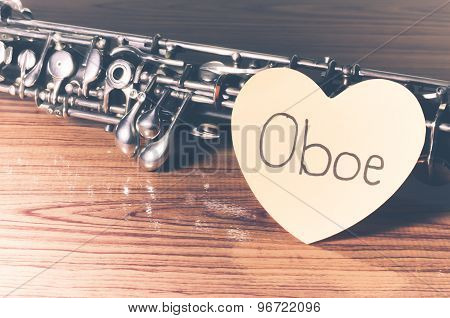 oboe with heart on wood table background