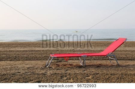 Sunlounger In The Middle Of The Beach In Summer