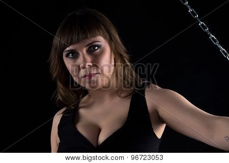 Photo of brunette woman and chain