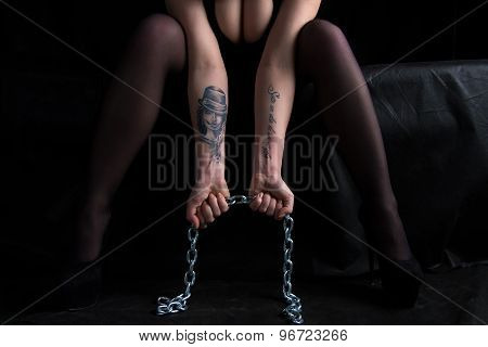 Image of sitting woman holding chain