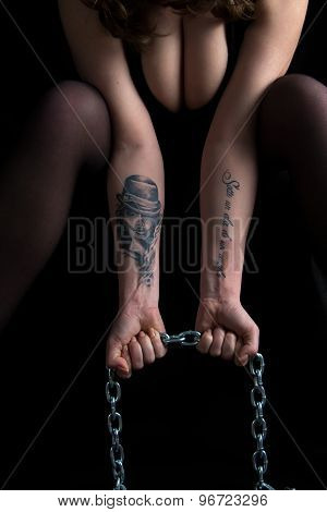 Photo woman's hands holding chain and breast